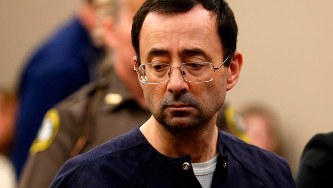 Former  Michigan State University and USA Gymnastics doctor Larry Nassar is pictured addressing the court during the sentencing phase in Ingham County Circuit Court in Lansing, Mich.