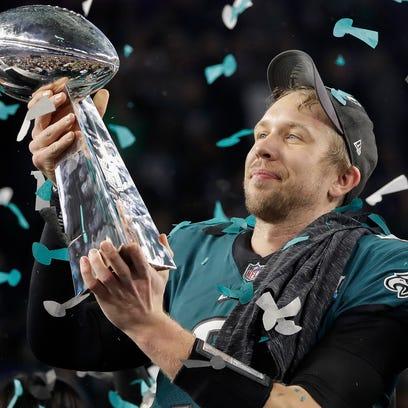 Philadelphia Eagles quarterback Nick Foles holds up
