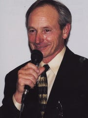 Triple Crown winning jockey Steve Cauthen of Verona serves as emcee during the oral auction at The Yearling's 25th anniversary gala at Triple Crown County Club.