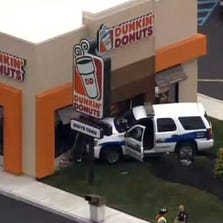An officer crashed into a Dunkin' Donuts in NJ early Friday