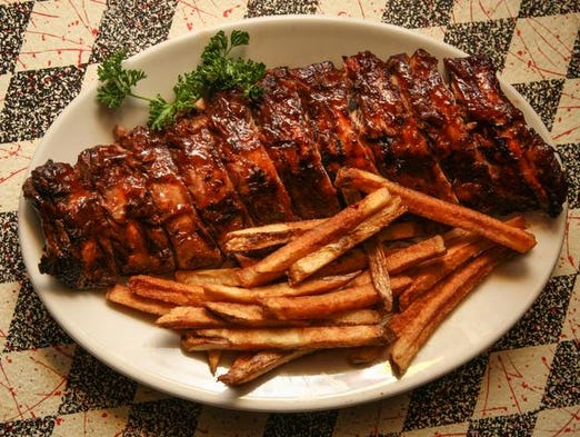 Baby Back Ribs with homemade fresh fries at Memphis Pig Out.