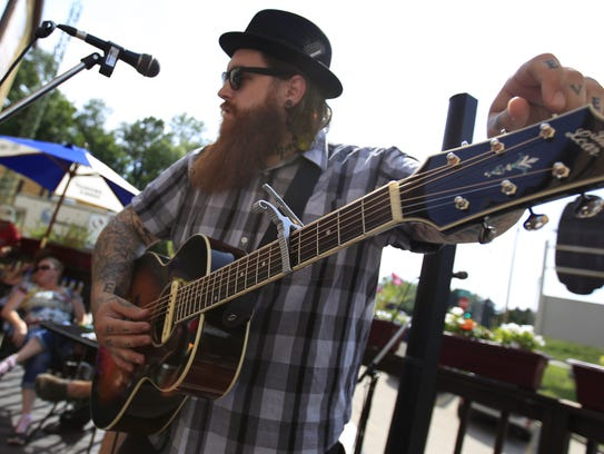 Christopher Gold performs at the Stone Cellar Brewpub
