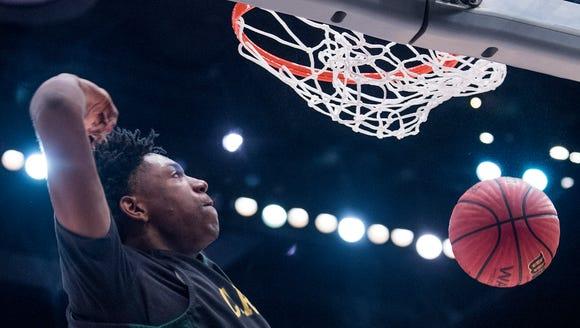 Carver's Jaykwon Walton dunks against Paul Bryant in