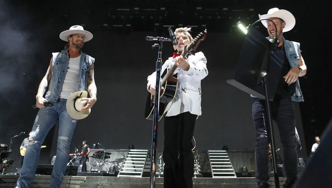 Yodel Boy Mason Ramsey performs with Florida Georgia Line at Stagecoach.
