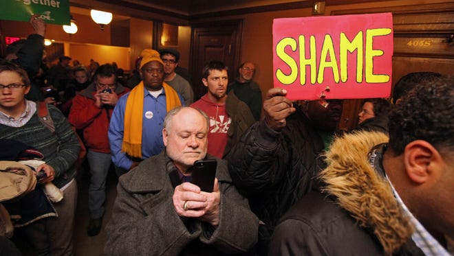 A crowd protests outside the doors of a hearing that was cut short for a right-to-work bill at the state Capitol in Madison on Tuesday.
