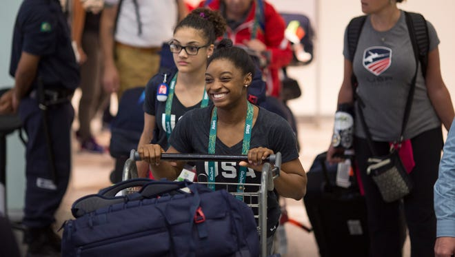 Here they come. Athletes, including U.S. gymnast Simone Biles, are pouring into Tom Jobim International Airport in Rio de Janeiro, Brazil, as opening day of the 2016 Summer Olympics draws near.