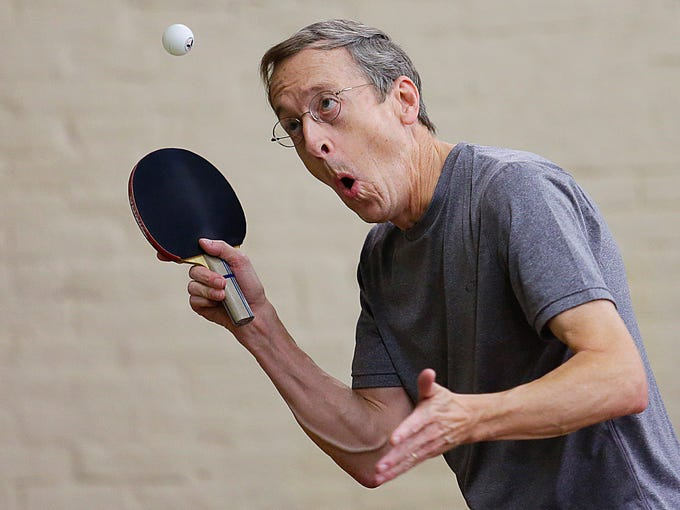 Barry Carlin of Cincinnati, Ohio watches the flight of his ball while playing in the Bernard Hock table tennis tournament at the Ed Endres Boys and Girls Complex on Ekin Avenue in New Albany, Indiana. October 12, 2013