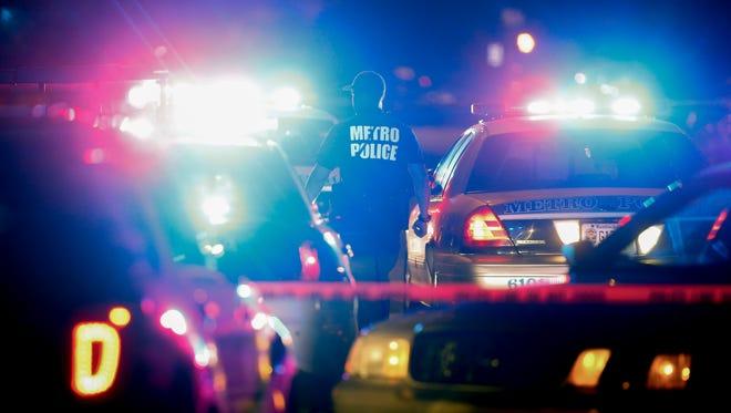 Louisville Metro Police work a shooting scene in the 800 block of East Chestnut street.
