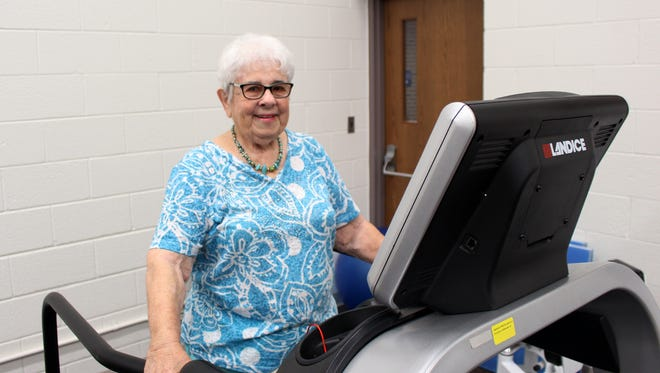 Leta Guild walks on a treadmill in the pulmonary rehab gym as part of her exercise maintenance program. Guild has been been working out at pulmonary rehabilitation three times a week for over 18 years.