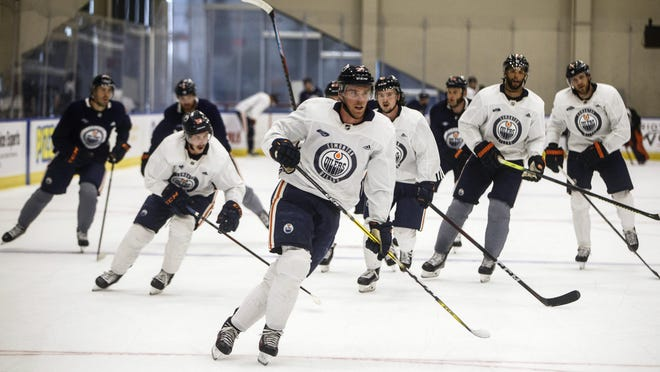 The Edmonton Oilers' Connor McDavid (97) leads a skate during practice for the upcoming return of NHL hockey in Edmonton on July 23. McDavid is one of several former Erie Otters who will compete in the playoffs.