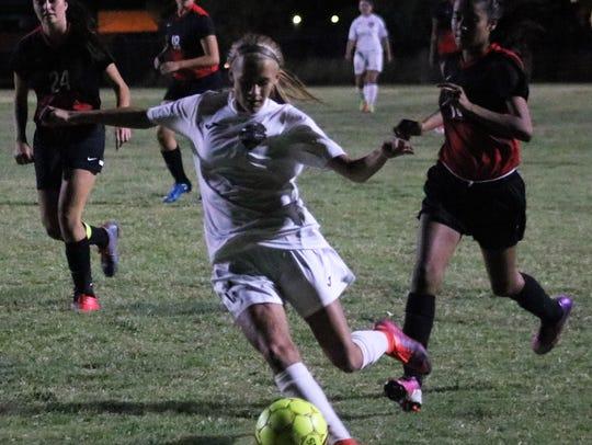 Alamogordo's Sheyenne Drake takes a shot at the goal.