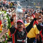 May 24, 2015; Indianapolis, IN, USA; IndyCar Series driver Juan Pablo Montoya celebrates after winning the 2015 Indianapolis 500 at Indianapolis Motor Speedway. Mandatory Credit: Mark J. Rebilas-USA TODAY Sports