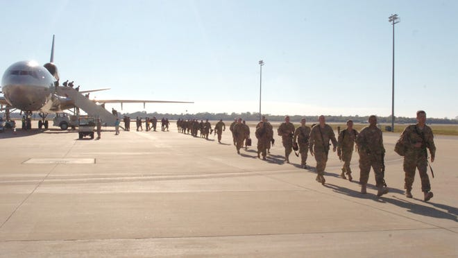 Soldiers stationed at Fort Polk return from a year-long deployment to Afghanistan to an Army processing facility located at England Airpark.