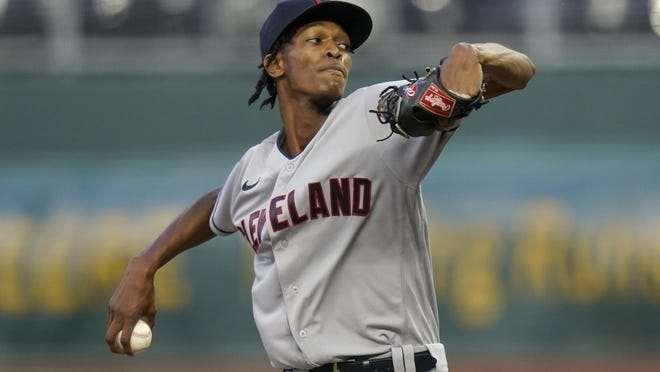 Cleveland Indians starting pitcher Triston McKenzie winds up during the first inning of the team's baseball game  against the Kansas City Royals at Kauffman Stadium in Kansas City, Mo., Wednesday, Sept. 2, 2020.