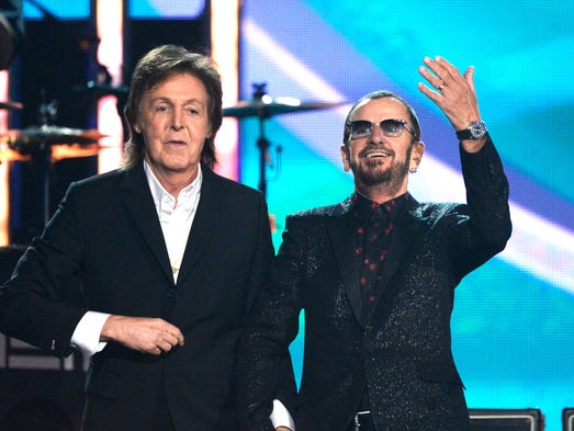 Musicians Paul McCartney (L) and Ringo Starr of The Beatles perform onstage during the 56th GRAMMY Awards at Staples Center on January 26, 2014 in Los Angeles, California.