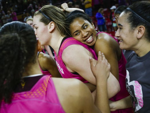 ASU's Arnecia Hawkins, right, embraces ASU's Sophie