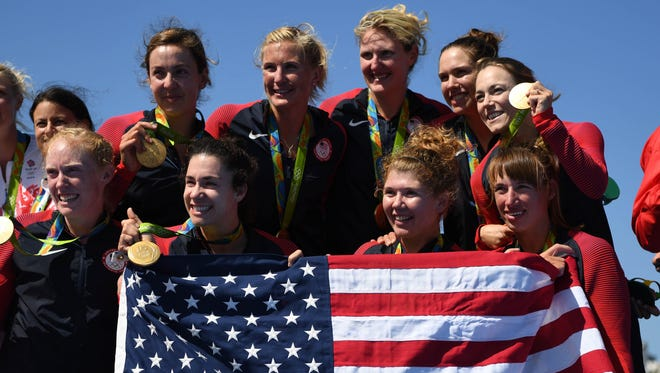 Team USA celebrates winning gold in the women's eight rowing competition in the Rio 2016 Summer Olympics.