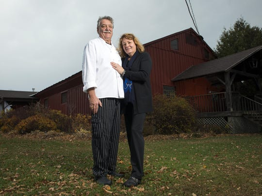 Lisa and Roland Gaujac, owners of the Old Lantern Inn in Charlotte.