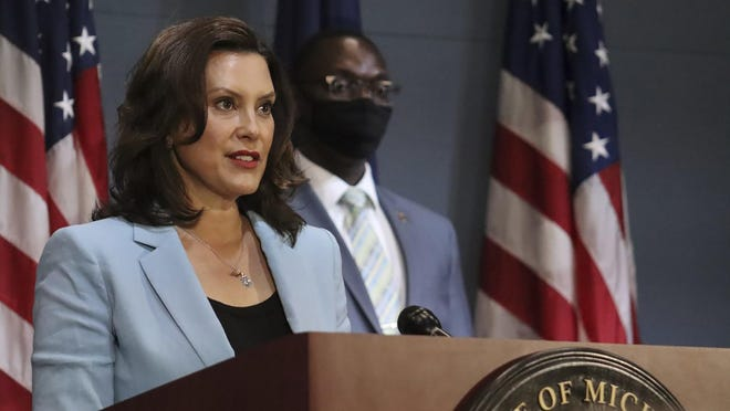 """In a pool photo provided by the Michigan Office of the Governor, Michigan Gov. Gretchen Whitmer addresses the state during a speech in Lansing, Mich., Thursday, July 9, 2020. All Michigan health workers must receive """"implicit bias"""" training tied to their professional licensure under a directive issued Thursday by Whitmer, who said the mandate will help address the coronavirus pandemic's disproportionate and deadly impact on people of color."""
