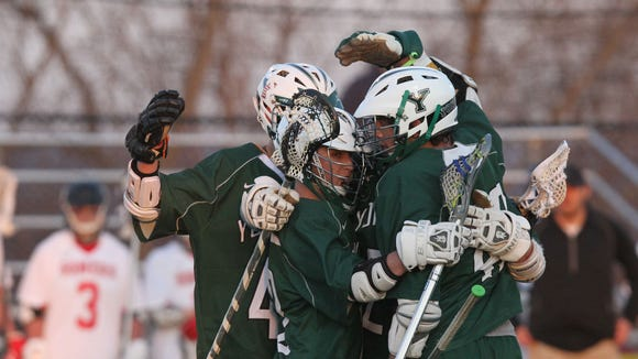 Yorktown players celebrate a first half goal against Somers during a boys lacrosse game at Somers High School April 10, 2014. Yorktown won the game 14-6.