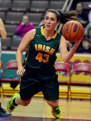 Gina Citrone of York Catholic passes the ball in the