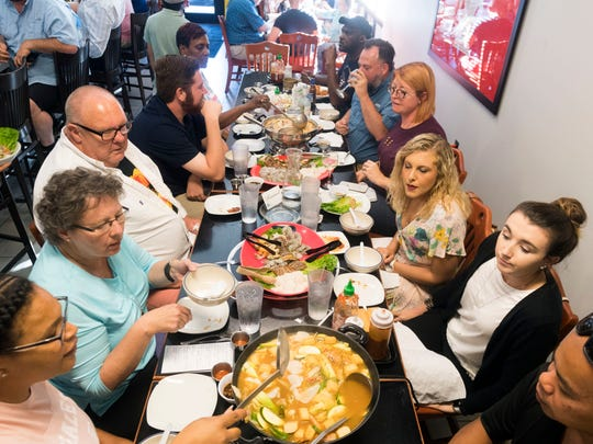 Guests enjoy a hot pot meal at Sticky Rice Cafe on Tuesday, June 5, 2018. Sticky Rice Cafe is offering hot pot dinners but they must be requested two weeks in advance.