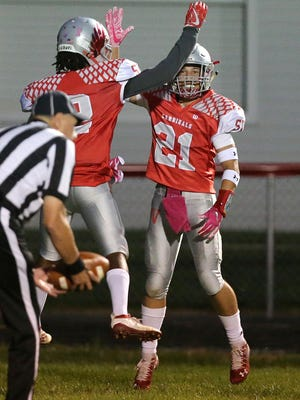 Sandy Valley's Brady Russell celebrates a big play against Strasburg. Russell is a first team All-Ohio defensive back and also one of the Cardinals' top receivers.