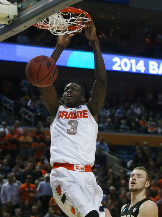 Syracuse's Jerami Grant (3) dunks the ball against Western Michigan during the first half of a second-round game of the NCAA college basketball tournament in Buffalo, N.Y., Thursday, March 20, 2014.  (AP Photo/The Buffalo News, Robert Kirkham) TV OUT; MAGS OUT; MANDATORY CREDIT; BATAVIA DAILY NEWS OUT; DUNKIRK OBSERVER OUT; JAMESTOWN POST-JOURNAL OUT; LOCKPORT UNION-SUN JOURNAL OUT; NIAGARA GAZETTE OUT; OLEAN TIMES-HERALD OUT; SALAMANCA PRESS OUT; TONAWANDA NEWS OUT