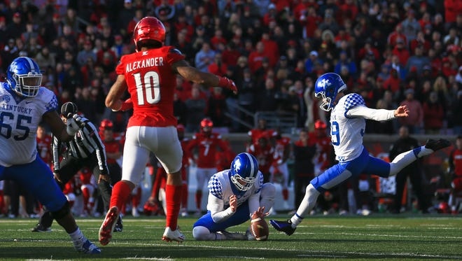 Kentucky kicker Austin MacGinnis launches to kick  a 47-yard field goal from holder Tristan Yeoman with 12 seconds remaining for a 41-38 win.