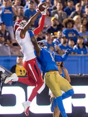 Fresno State's KeeSean Johnson, left, goes up for a