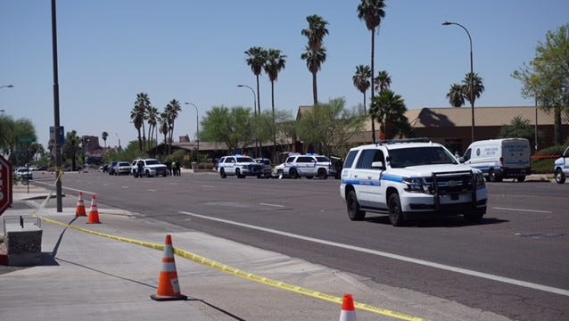 Police tape blocked off the street where officers were involved in a shooting May 5, 2018, near Scottsdale and McDowell roads in Scottsdale.