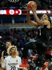 Trevon Duval, right, drives to the basket during the second half of the McDonald's All- American boys high school basketball game