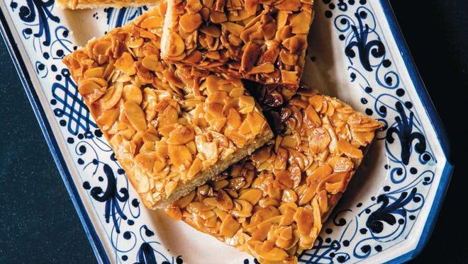 Bienenstich, or honey almond caramel cake, is a favorite German baked good.