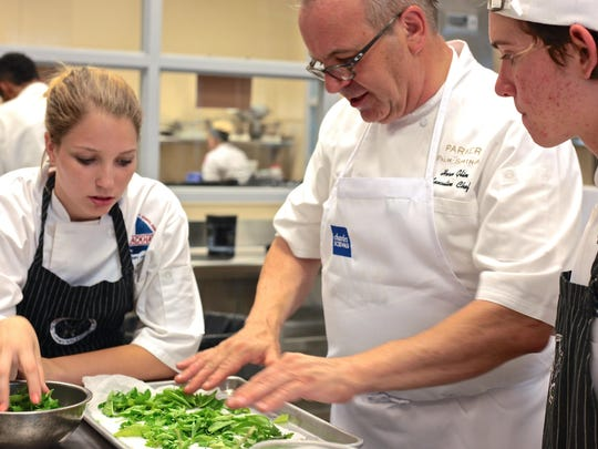Executive Chef, Herve Glin, and his team of Blackhawk students prepare a duck entrée with scallops and avocado during a culinary showdown at La Quinta High School, Thursday.