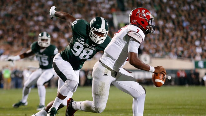 Michigan State defensive end Demetrius Cooper (98) chases Jacksonville State quarterback Eli Jenkins during the first half last season in East Lansing.