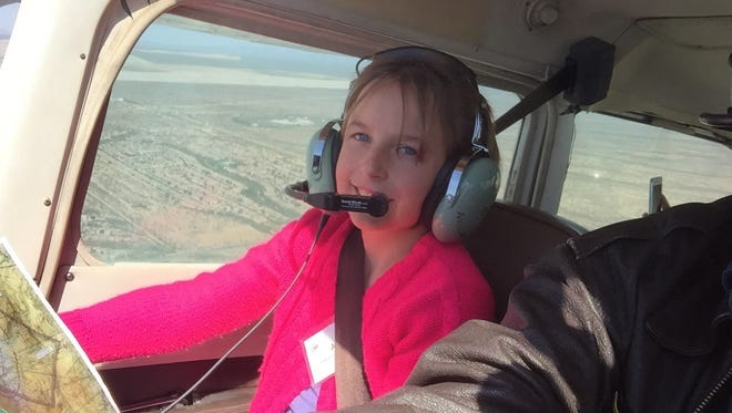 A smiling AHA student takes to the skies during her flight lesson