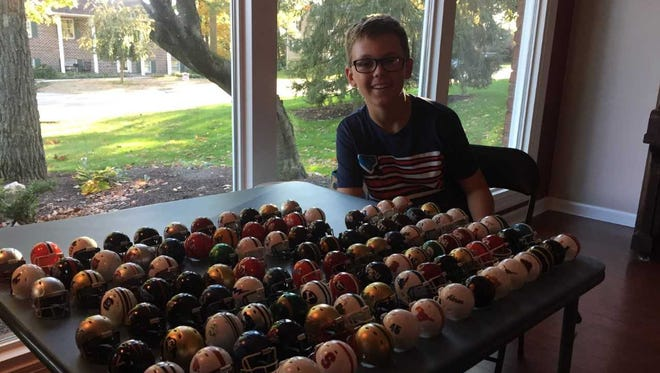 Dalton Stickler, 11, of Hanover, picks every college football game every week by lining up his collection of mini-helmets. His picks got him airtime during ABC's national broadcast of the Penn State-Michigan game.