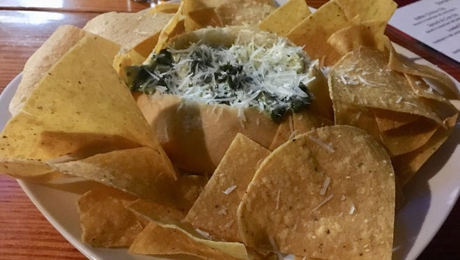 Pryme Tyme Sports Bar's crab and spinach dip was a cream cheese based dip loaded with shredded spinach, bits of crab and topped with Parmesan cheese. It was served in a small bread bowl surrounded by tortilla chips.