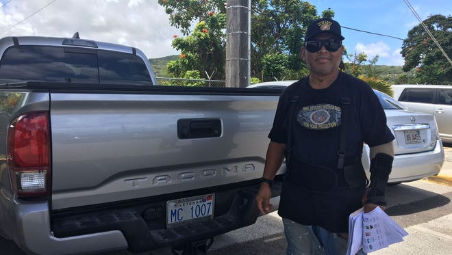 Disabled veteran, Evangelis (Ivan) Babauta poses with his veteran license plate at the VA Guam Community Based Outpatient Clinic in Hagåtña on April 5, 2018 Thursday morning.