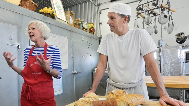 Collegeville Artisan Bakery operators Steve Nelson and Mary Ann Friedrichs talk about the use of organic red fife flour Thursday, April 14, at their bakery.