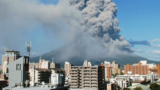 In this photo released by Kagoshima Local Meteorological Observatory, volcanic smoke billows from Mount Sakurajima in Kagoshima on Sunday.