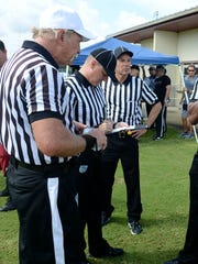 Officials gather for a preseason football clinic.