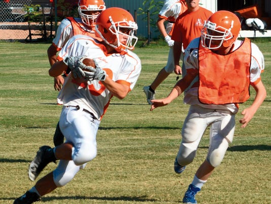 Artesia senior slot receiver Darius Ramirez finds an open crease after making a catch at last Monday's practice.