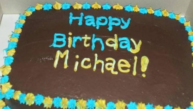 Michael Herzog's birthday cake from Birthday Cakes 4 Free, Johnson County, is seen.