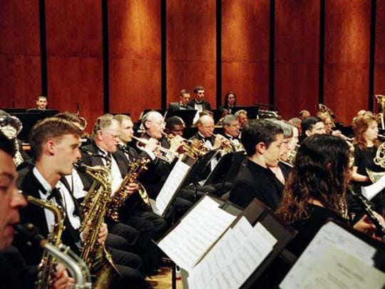 Focused members of the Tallahassee Winds Ensemble mid-performance.