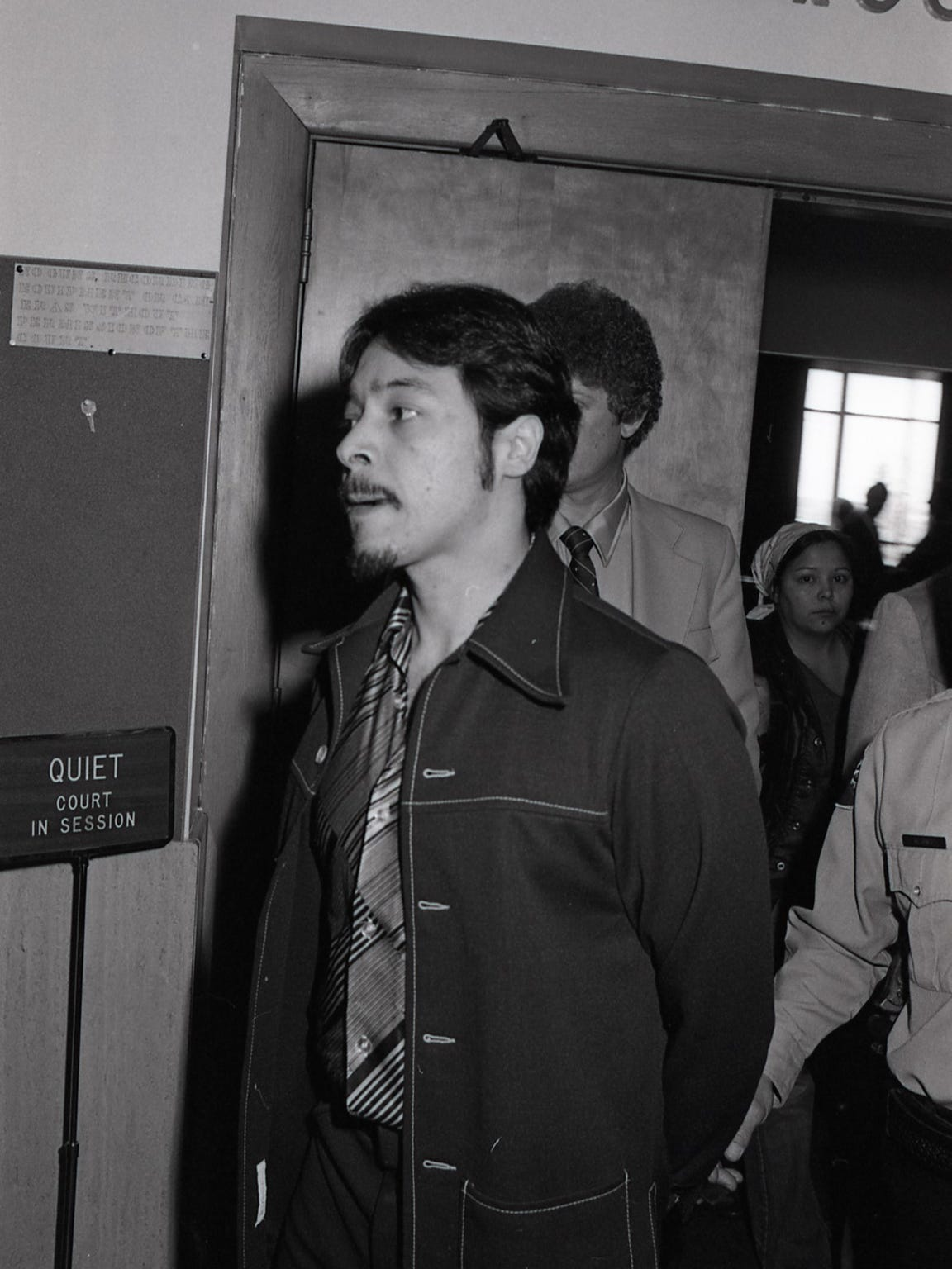 Santos Romero Jr. is shown being led out of the courtroom