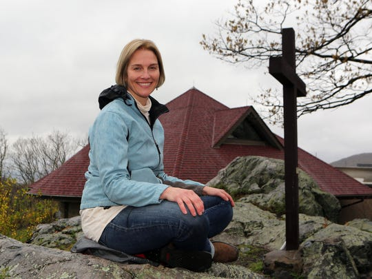 """Amy Reyer, who leads meditation classes at the Graymoor Spiritual Life Center in Garrison, is pictured at the top of the """"Holy Mountain"""" on the property April 25, 2017."""