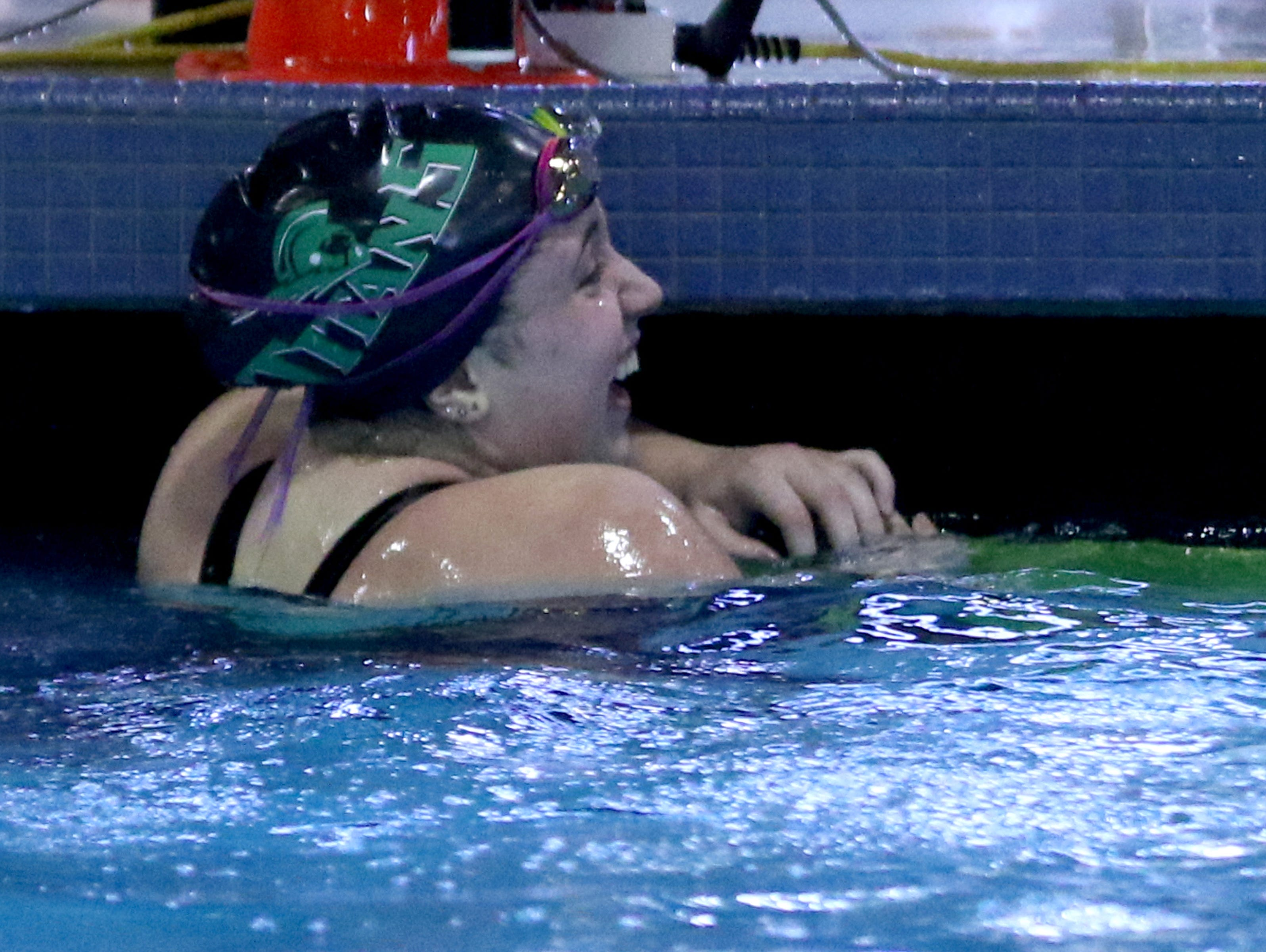 West Salem's Alaina Otterstrom smiles after winning the 100 yard butterfly during the Greater Valley Conference swimming championships at the McMinnville Aquatic Center on Saturday, Feb. 11, 2017.