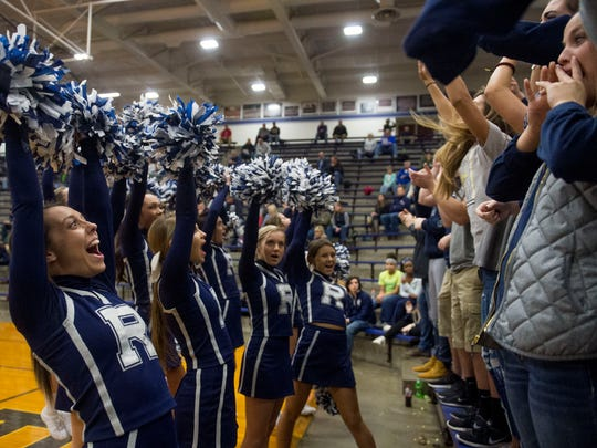 Reitz cheerleader Paige Ferguson, left, cheers in front of Riley Deweese as the Reitz Panthers take on the Henderson County Colonels at Reitz High School in Evansville, Ind., on Tuesday, Dec. 12, 2017. Henderson County won 67-60.
