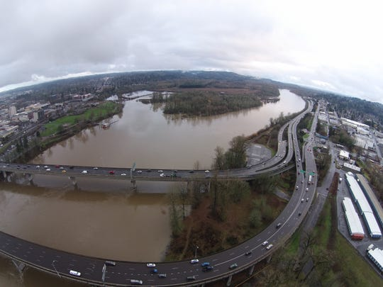 Drone's eye view from above the bridges over the Willamette River in downtown Salem